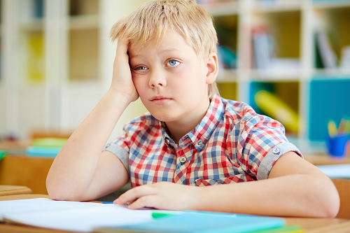 boy student looking frustrated when taking test